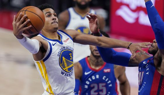 Golden State Warriors guard Jordan Poole (3) makes a layup as Detroit Pistons guard Saddiq Bey (41) defends during the first half of an NBA basketball game Tuesday, Dec. 29, 2020, in Detroit. (AP Photo/Carlos Osorio)