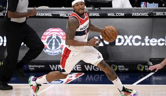 Washington Wizards guard Bradley Beal (3) dribbles the ball during the first half of an NBA basketball game against the Chicago Bulls, Tuesday, Dec. 29, 2020, in Washington. (AP Photo/Nick Wass)