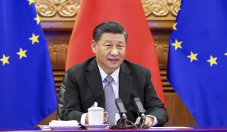 In this photo released by Xinhua News Agency, Chinese President Xi Jinping speaks during a video conference with European leaders from Beijing on Wednesday, Dec. 30, 2020. European Union top officials and Chinese President Xi Jinping have concluded a long-awaited business investment deal with the potential to annoy the new American administration. (Li Xueren/Xinhua via AP)