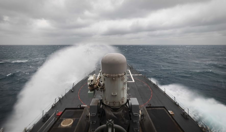 In this photo provided by the U.S. Navy, the guided-missile destroyer USS John S. McCain conducts routine underway operations in support of stability and security for a free and open Indo-Pacific, at the Taiwan Strait, Wednesday, Dec. 30, 2020. China accused the U.S. of staging a show of force by sailing two Navy warships through the Taiwan Strait on Thursday morning. The Navy said the Arleigh Burke-class guided missile destroyers USS John S. McCain and USS Curtis Wilbur conducted a routine Taiwan Strait transit in accordance with international law.(Mass Communication Specialist 2nd Class Markus Castaneda/U.S. Navy via AP)