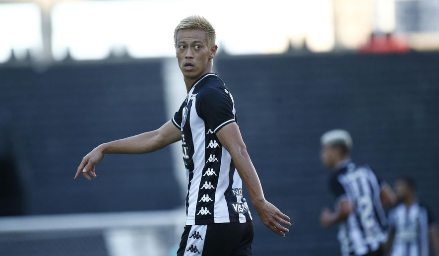 Botafogo's Keisuke Honda, of Japan, is seen during a Carioca Championship soccer match against Bangu in Rio de Janeiro, Brazil, Sunday, March 15, 2020. The match was played in an empty, closed door stadium to contain transmission of the new coronavirus. (AP Photo/Bruna Prado)