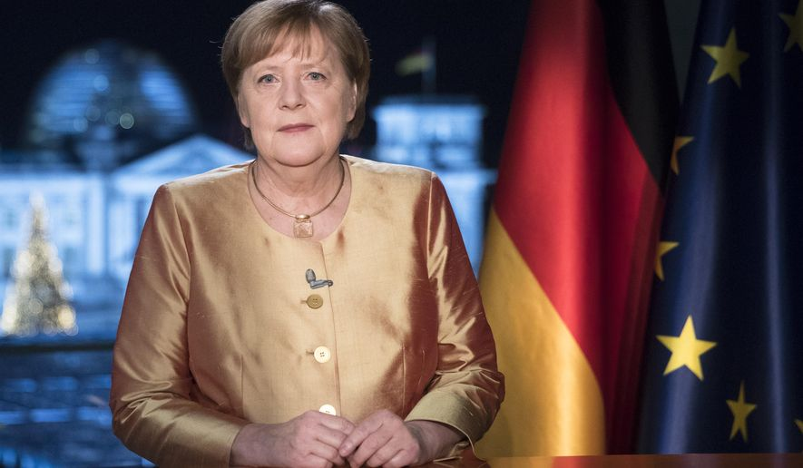EMBARGO - UNTIL DEC. 31 00:00 A.M. CET - FREE FOR THURSDAY DEC. 31, 2020 NEWSPAPERS - German Chancellor Angela Merkel poses for photographs after the television recording of her annual New Year's speech at the chancellery in Berlin, Germany, Wednesday, Dec. 30, 2020. (AP Photo/Markus Schreiber, pool)