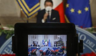 Italian Premier Giuseppe Conte is framed in a viewfinder of a camera as he gives his year end press conference, in Rome, Wednesday, Dec. 30, 2020. (AP Photo/Andrew Medichini, pool)