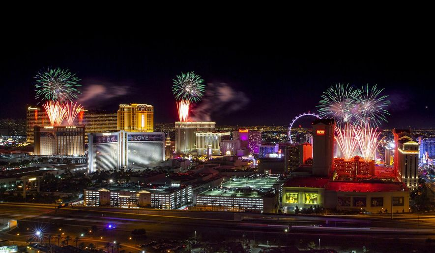 FILE- IN this Jan. 1, 2020 file photo, fireworks for New Year's Eve erupt over the Strip as viewed from the VooDoo Rooftop Nightclub & Lounge at Rio All-Suite Hotel & Casino on in Las Vegas. If ever a year's end seemed like cause for celebration, 2020 might be it. Yet the coronavirus scourge that dominated the year is also looming over New Year's festivities and forcing officials worldwide to tone them down. (L.E. Baskow/Las Vegas Review-Journal via AP, File)