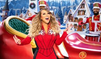 "Mariah Carey performs during her holiday special ""Mariah Carey's Magical Christmas Special"" on Apple TV+. (Apple TV+ via AP)"