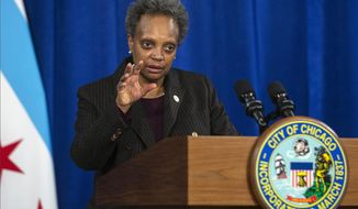 """FILE - In this Dec. 17, 2020, file photo, Chicago Mayor Lori Lightfoot speaks during a news conference at City Hall in Chicago. Lightfoot was first told in November 2019 of a """"pretty bad wrongful raid"""" on the home of a Black woman who wasn't allowed to dress before police handcuffed her, according to emails released publicly Wednesday, Dec. 30, 2020. The more than 150 pages of emails between top city aides clear up the timeline of when Lightfoot found out about the February 2019 botched raid on the home of Anjanette Young. The incident and the city's response has prompted nationwide criticism, led to the ouster of the city's top attorney and put 12 police officers on desk duty pending an investigation. (Anthony Vazquez/Chicago Sun-Times via AP, File)"""