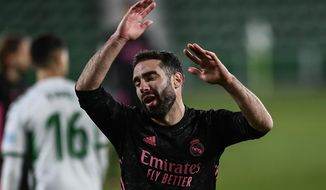 Real Madrid's Dani Carvajal reacts during the Spanish La Liga soccer match between Real Madrid and Elche CF at the Manuel Martinez Valero stadium in Elche, Spain, Wednesday, Dec. 30, 2020. (AP Photo/Jose Breton)