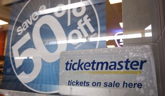 In this May 11, 2009, file photo, a Ticketmaster advertisement is posted at a Ticketmaster box office in San Jose, Calif. On Wednesday, Dec. 30, 2020, a federal judge in New York signed off on a deal that will allow Ticketmaster to pay a $10 million fine to escape prosecution over criminal charges accusing the company of hacking into the computer system of a startup rival. (AP Photo/Paul Sakuma, File)  **FILE**