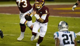 Washington Football Team quarterback Taylor Heinicke scrambles during an NFL football game against the Carolina Panthers, Sunday, Dec. 27, 2020, in Landover, Md. Until a relief appearance Sunday, Heinicke hadn't played an NFL game since 2018 and was an XFL backup, and now Heinicke could start or be one Alex Smith injury away in the season finale at Philadelphia with the NFC East on the line.(AP Photo/Mark Tenally)