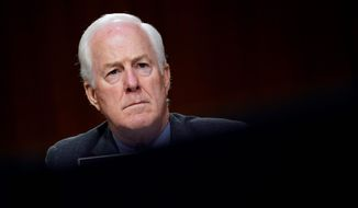 """I think we need to address 230, but I just think this is not the right way to do it,"" Sen. John Cornyn, Texas Republican, said about linking the relief checks to the Big Tech liability protection. (Associated Press)"