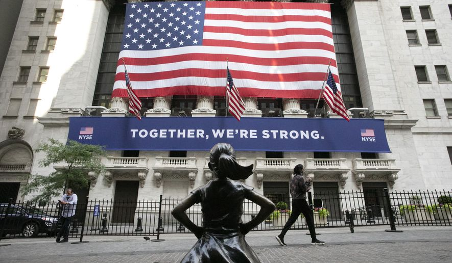 In this July 9, 2020 file photo, the Fearless Girl statue stands in front of the New York Stock Exchange in New York. Stocks are off to a mixed start, Thursday, Dec. 31,  on Wall Street on the last day of 2020, a year that saw a breathtaking nosedive in markets in the spring as the coronavirus took hold followed by steady gains in the months that followed as hopes built for an eventual return to something like normal.  (AP Photo/Mark Lennihan, File)