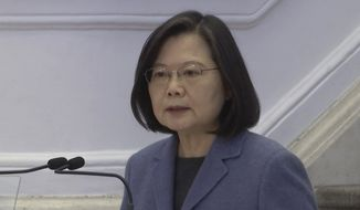 In this image from video, Taiwanese President Tsai Ing-wen delivers a speech at the Office of the President in Taipei, Taiwan, Friday, Jan. 1, 2021. Tsai hailed the island's progress in containing the coronavirus pandemic and growing the economy while facing military threats from China. (AP Photo/Wu Taijing)