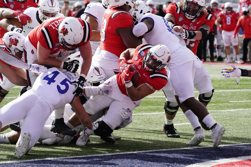 Ball State running back Tye Evans (30) scores a touchdown against San Jose State in the first half of the Arizona Bowl NCAA college football game, Thursday, Dec. 31, 2020, in Tucson, Ariz. (AP Photo/Rick Scuteri)