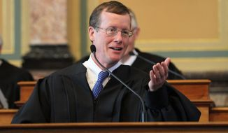 """FILE - In this June 3, 2011, file photo, Iowa Supreme Court Justice Edward Mansfield speaks in Des Moines, Iowa. The Iowa Supreme Court on Thursday, Dec. 31, 2020, limited the legal damages that can be awarded for injuries and deaths caused by state police officers who are found to have used excessive force. Justice Mansfield wrote for the majority that compensatory damages for victims, including for emotional distress and attorney fees, would still be available and offer """"an adequate remedy."""" (Rodney White/The Des Moines Register via AP)"""