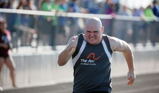 """In this photo provided by Gary Schottle, Derek """"Tank"""" Schottle competes in the 100 meter dash as part of the Pentathlon at a Special Olympics track meet in Rosenburg, Texas, on April 8, 2017. Gary Schottle arrived at the school in time to see the other kids in line hitting and jumping on his young son. Schottle had the same thoughts any other parents would, wondering how the kids could be so mean and why Derek didn't stick up for himself. Special Olympics changed everything for Tank. He blossomed into a leader, spreading love an inspiration to everyone he met. (Gary Schottle via AP)"""