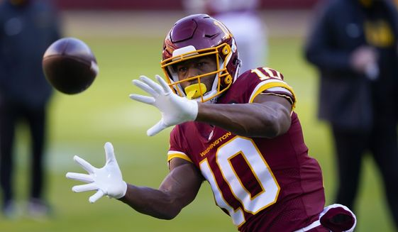 Washington Football Team wide receiver Antonio Gandy-Golden (10) makes a catch before the start of an NFL football game against the Carolina Panthers and Washington Football Team, Sunday, Dec. 27, 2020, in Landover, Md. (AP Photo/Susan Walsh) **FILE**