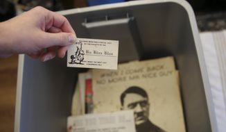 Some of the racist material collected over decades by former Ku Klux Klan leader John Howard is seen on Dec. 9, 2020, in Columbia, S. C.. Howard also ran The Redneck Store in Laurens, South Carolina, for decades. The Echo Group is renovating the shop into a community center and racial reconciliation museum. (AP Photo/Jeffrey Collins)