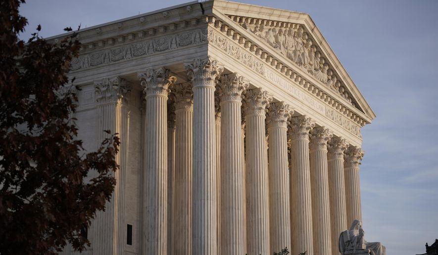 This Nov. 5, 2020 file photo, shows the Supreme Court in Washington.(AP Photo/J. Scott Applewhite, File) **FILE**