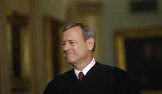 FILE - In this Jan. 16, 2020, file photo Chief Justice of the United States, John Roberts walks to the Senate chamber at the Capitol in Washington. (AP Photo/Matt Rourke, File)