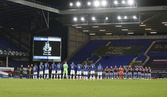 Everton and West Ham players commemorates COVID-19 victims during the English Premier League soccer match between Everton and West Ham at Goodison Park in Liverpool, England, Friday, Jan. 1, 2021. (Jan Kruger,Pool via AP)