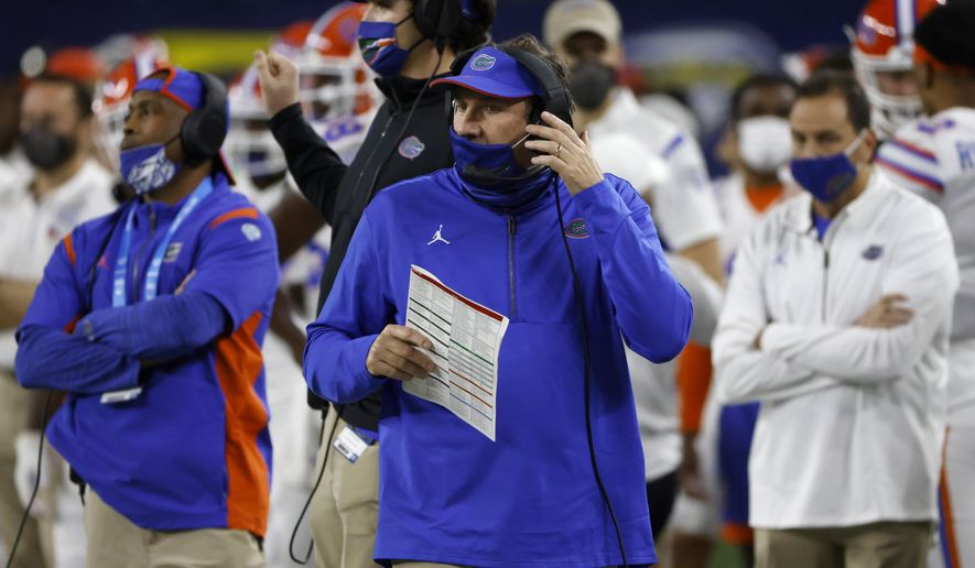 Florida coach Dan Mullen, center, watches play against Oklahoma during the first half of the Cotton Bowl NCAA college football game in Arlington, Texas, Wednesday, Dec. 30, 2020. (AP Photo/Ron Jenkins)