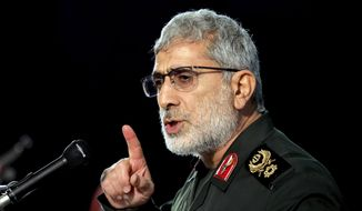 Gen. Esmail Ghaani, Soleimani's successor as the new head of Quds Force speaks during a ceremony on the occasion of first anniversary of death of the force's previous head Gen. Qassem Soleimani, in Tehran, Iran, Friday, Jan. 1, 2021. The top commander of Iran's paramilitary Revolutionary Guard said Friday that his country was fully prepared to respond to any U.S. military pressure, amid heightened tensions between Tehran and Washington in the waning days of President Donald Trump's administration. (AP Photo/Ebrahim Noroozi)