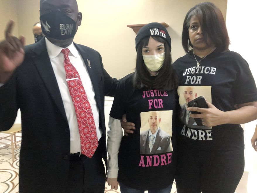 """Attorney Benjamin Crump, left, discusses the police shooting of Andre Hill at a news conference attended by Hill's daughter, Karissa, center, and sister Shawna Barnett, on Thursday, Dec. 31, 2020, in Columbus, Ohio. Karissa Hill said she considered her father an """"everything man"""" because he did so many things. (AP Photo/Andrew Welsh-Huggins)"""
