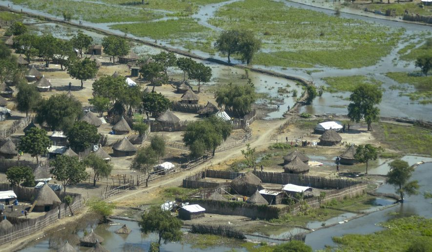 Thatched huts surrounded by floodwaters are seen from the air in Old Fangak county, Jonglei state, South Sudan Friday, Nov. 27, 2020. Some 1 million people in the country have been displaced or isolated for months by the worst flooding in memory, with the intense rainy season a sign of climate change. (AP Photo/Maura Ajak) ** FILE **