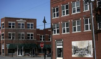 FILE - In this Feb. 12, 2019 file photo, historic buildings on Greenwood, the Historic Black Wall Street, house new businesses in Tulsa, Oklahoma. A $500,000 grant announced Tuesday, April 8, 2020, from the National Park service will be used to renovate buildings along Tulsa's former Black Wall Street. It comes nearly 100 years after the area was largely destroyed and as many as 300 people were killed in one of the nation's deadliest outbreaks of racial violence. (John Clanton/Tulsa World via AP File)
