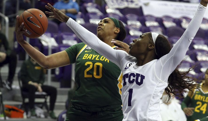 Baylor center Hannah Gusters (20) goes up for a shot against TCU guard Aahliyah Jackson (1) during the second half of an NCAA college basketball game, Saturday, Jan. 2, 2021. (AP Photo/ Richard W. Rodriguez)