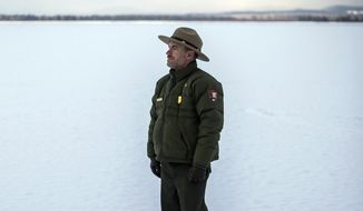 Jeremy Barnum stands for a portrait Dec. 11, 2020, on the frozen surface of Jackson Lake in Grand Teton National Park, Wyo. Barnum officially started his tenure as Grand Teton's chief of staff in May. A native of northern Utah, his career with the U.S. Foreign Service sent him to Finland and Ecuador before landing back in Washington, D.C., where he pivoted to communications work with the National Park Service. (Ryan Dorgan/Jackson Hole News & Guide via AP)