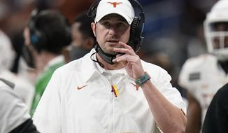 FILE - This Dec. 29, 2020 file photo shows Texas head coach Tom Herman during the second half of the Alamo Bowl NCAA college football game against Colorado in San Antonio.  Texas has fired football Herman, Saturday, Jan. 2, 2021, after four seasons of failing to win a Big 12 championship and making only one appearance in the league title game. (AP Photo/Eric Gay, File)