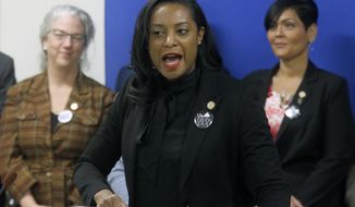 FILE - Jan. 22, 2019 file photo, Del. Jennifer Carroll Foy, D-Prince William, center, speaks during a news conference of ERA (Equal Rights Amendment) supporters after her ERA bill was killed by a House subcommittee inside the Pocahontas Building in Richmond, Va. An unusually broad field is vying to be the next governor of Virginia as the marquee political contest of 2021 gets into full swing.    (Bob Brown/Richmond Times-Dispatch via AP)