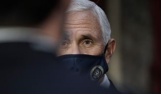Vice President Mike Pence finishes a swearing-in ceremony for senators in the Old Senate Chamber at the Capitol in Washington, Sunday, Jan. 3, 2021. (AP Photo/J. Scott Applewhite, Pool) **FILE**