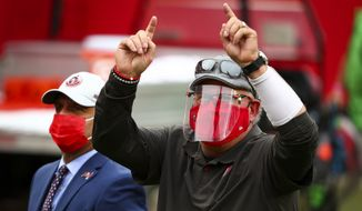 Tampa Bay Buccaneers head coach Bruce Arians smiles and waves to fans after beating the Atlanta Falcons in an NFL football game, Sunday, Jan. 3, 2021, in Tampa, Fla. (AP Photo/Kevin Sabitus)  **FILE**