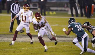 Washington Football Team's Antonio Gibson (24) plays during the second half of an NFL football game against the Philadelphia Eagles, Sunday, Jan. 3, 2021, in Philadelphia. (AP Photo/Chris Szagola)