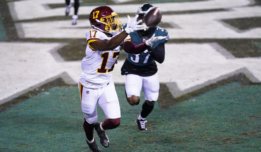 Washington Football Team's Terry McLaurin (17) catches a touchdown pass against Philadelphia Eagles' Grayland Arnold (37) during the first half of an NFL football game, Sunday, Jan. 3, 2021, in Philadelphia. (AP Photo/Chris Szagola)