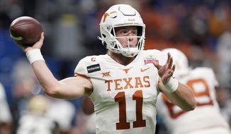 Texas quarterback Sam Ehlinger (11) throws a pass against Colorado during the first half of the Alamo Bowl NCAA college football game Tuesday, Dec. 29, 2020, in San Antonio. (AP Photo/Eric Gay)