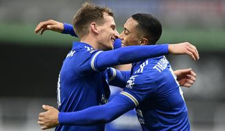 Leicester's Youri Tielemans, right, celebrates with teammates after scoring his side's second goal during the English Premier League soccer match between Newcastle United and Leicester City at St. James' Park in Newcastle, England, Sunday, Jan. 3, 2021. (Michael Regan/Pool via AP)