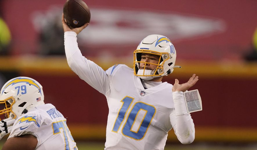 Los Angeles Chargers quarterback Justin Herbert throws a pass during the first half of an NFL football game against the Kansas City Chiefs, Sunday, Jan. 3, 2021, in Kansas City. (AP Photo/Charlie Riedel)