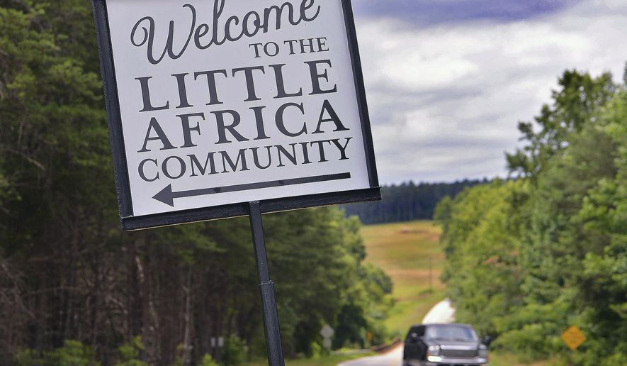 A sign welcomes motorists to the Little Africa community, off of state Highway 9 in Spartanburg County, S.C., Monday, July 6, 2020. Recent racial vandalism has brought members of the community closer. (Tim Kimzey/Spartanburg Herald-Journal via AP)
