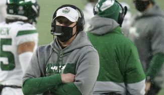 New York Jets head coach Adam Gase watches from the sideline in the second half of an NFL football game against the New England Patriots, Sunday, Jan. 3, 2021, in Foxborough, Mass. (AP Photo/Charles Krupa)