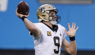 New Orleans Saints quarterback Drew Brees passes against the Carolina Panthers during the first half of an NFL football game Sunday, Jan. 3, 2021, in Charlotte, N.C. (AP Photo/Gerry Broome)