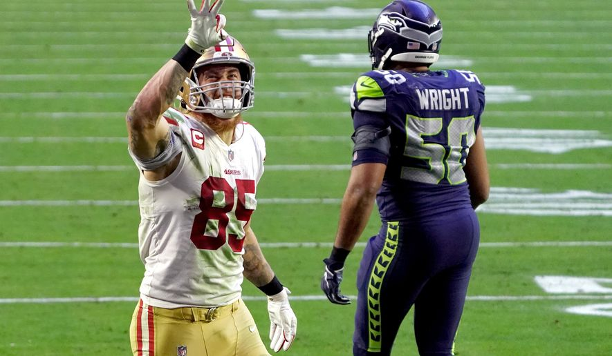 San Francisco 49ers tight end George Kittle (85) signals after a first down as Seattle Seahawks outside linebacker K.J. Wright (50) walks away during the second half of an NFL football game, Sunday, Jan. 3, 2021, in Glendale, Ariz. (AP Photo/Rick Scuteri)