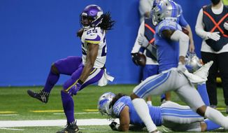 Minnesota Vikings running back Alexander Mattison (25) breaks away from Detroit Lions outside linebacker Jahlani Tavai for a touchdown during the first half of an NFL football game, Sunday, Jan. 3, 2021, in Detroit. (AP Photo/Duane Burleson)
