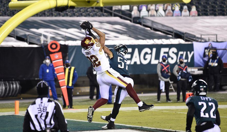 Washington Football Team's Logan Thomas (82) catches a touchdown against Philadelphia Eagles' T.J. Edwards (57) during the first half of an NFL football game, Sunday, Jan. 3, 2021, in Philadelphia. (AP Photo/Derik Hamilton)