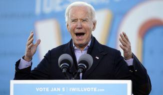 President-elect Joe Biden speaks in Atlanta, Monday, Jan. 4, 2021, as he campaigns for Senate candidates Raphael Warnock and Jon Ossoff. (AP Photo/Carolyn Kaster)