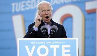 President-elect Joe Biden speaks in Atlanta, Monday, Jan. 4, 2021, as he campaigns for Georgia Democratic candidates for U.S. Senate, Raphael Warnock and Jon Ossoff. (AP Photo/Carolyn Kaster)