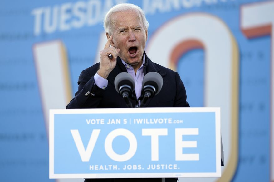 President-elect Joe Biden speaks in Atlanta, Monday, Jan. 4, 2021, as he campaigns for Georgia Democratic candidates for U.S. Senate, Raphael Warnock and Jon Ossoff. (AP Photo/Carolyn Kaster)
