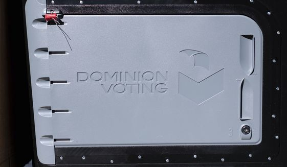 A Dominion Voting ballot scanner is delivered to a polling location in Gwinnett County, Ga. outside of Atlanta on Monday,  Jan. 4, 2021, in advance of the Senate runoff election. (AP Photo/Ben Gray)